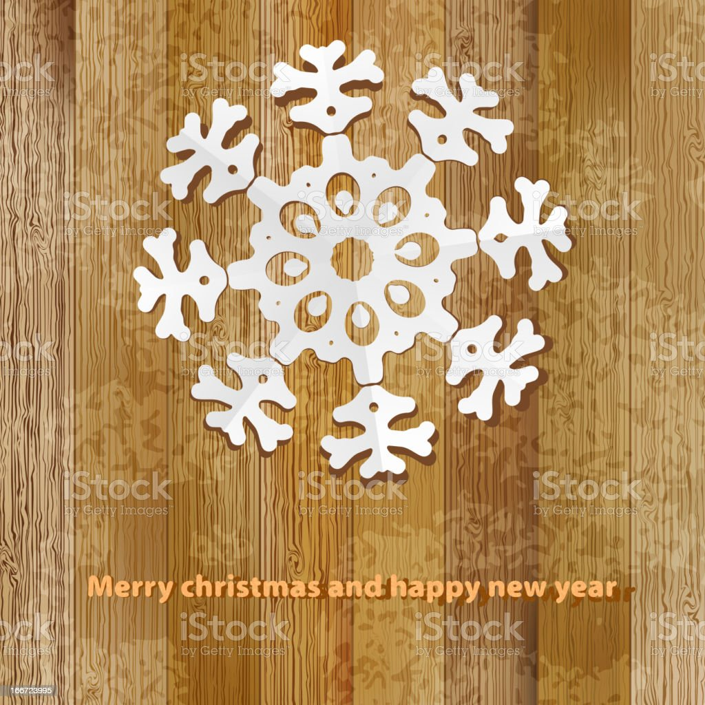 White paper christmas snowflake on a wood.  + EPS8 royalty-free stock vector art