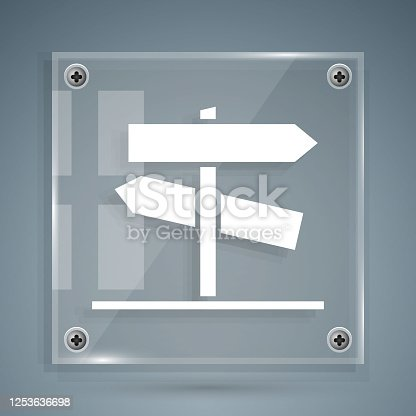 istock White Road traffic sign. Signpost icon isolated on grey background. Pointer symbol. Street information sign. Direction sign. Square glass panels. Vector Illustration 1253636698