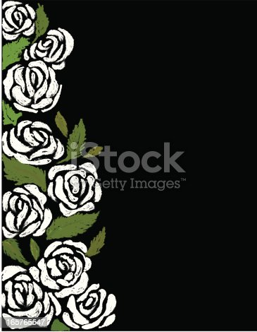 White roses and green leaves on the side of a black backdrop