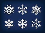 White set of snowflakes on dark blue background.