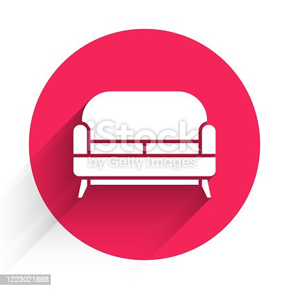 White Sofa icon isolated with long shadow. Red circle button. Vector Illustration