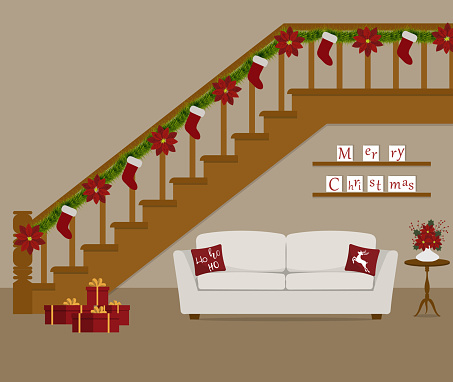 White sofa with red pillows, located under the stairs, decorated with Christmas decoration