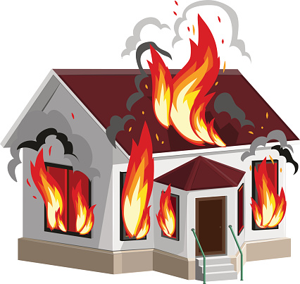 White stone house burns. Property insurance against fire. Home insurance