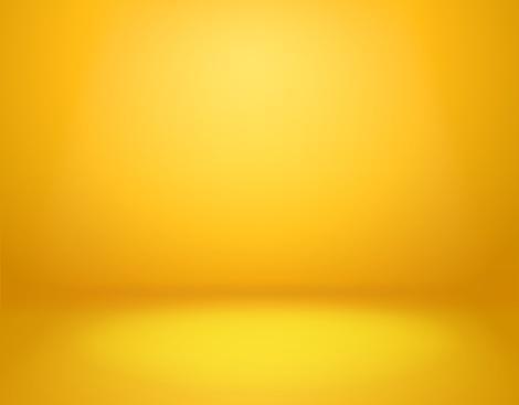 Yellow studio background. Empty vivid yellow studio room, modern workshop interior in perspective. Website wallpaper vector golden gradient spotlight mockup