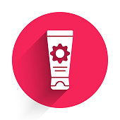 White Sunscreen cream in tube icon isolated with long shadow. Protection for the skin from solar ultraviolet light. Red circle button. Vector Illustration
