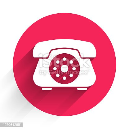 istock White Telephone icon isolated with long shadow. Landline phone. Red circle button. Vector Illustration 1270642651