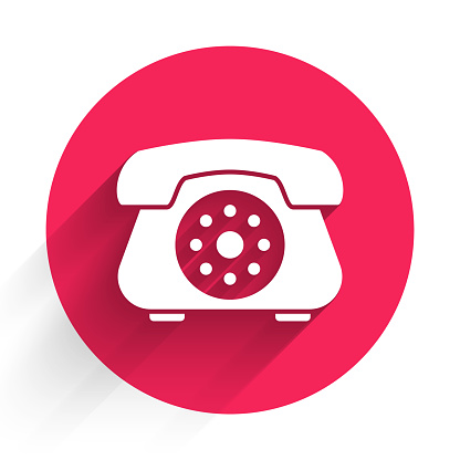 White Telephone icon isolated with long shadow. Landline phone. Red circle button. Vector Illustration