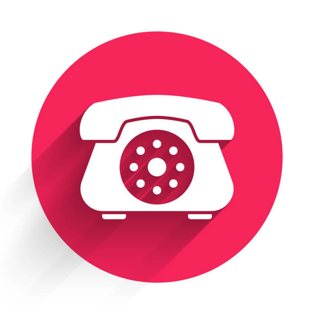 White Telephone icon isolated with long shadow. Landline phone. Red circle button. Vector Illustration White Telephone icon isolated with long shadow. Landline phone. Red circle button. Vector Illustration business clipart stock illustrations