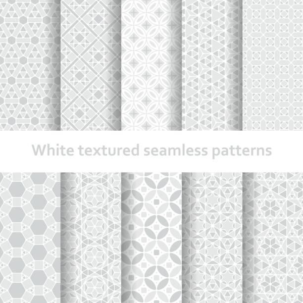 White textured seamless patterns set vector art illustration