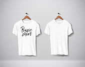 White T-Shirts Mock-up clothes with lettering an V and round neck hanging on wall.