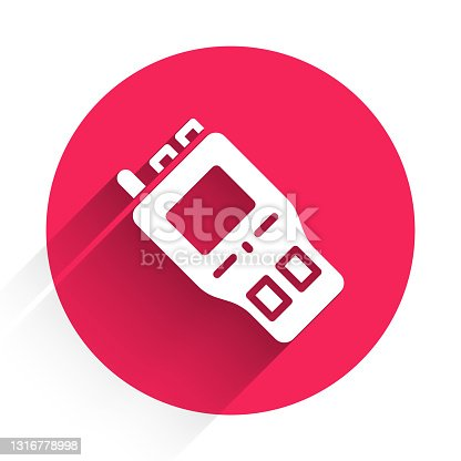 istock White Walkie talkie icon isolated with long shadow. Portable radio transmitter icon. Radio transceiver sign. Red circle button. Vector 1316778998