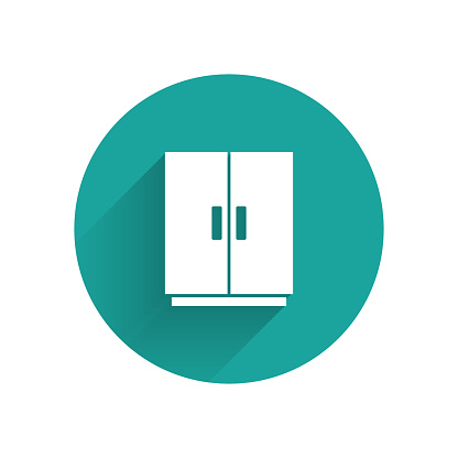 White Wardrobe icon isolated with long shadow. Green circle button. Vector