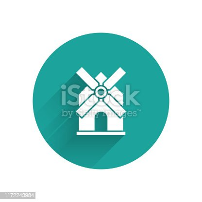 White Windmill icon isolated with long shadow. Green circle button. Vector Illustration