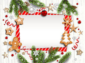 Holiday illustration with balls, gingerbreads, stars, snowflakes on white wood background. Christmas festive template.