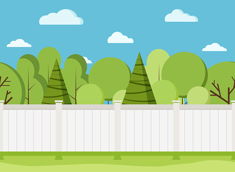 White wooden fence with trees. Modern rural white fence with green grass.