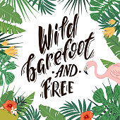 Wild barefoot and free. Hand drawn lettering on tropical background with flamingo