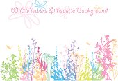 A vector silhouette illustration of multicoloured wildflowers with a text box and curly font above with cartoon sketched flowers.