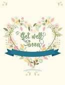 Wildflowers floral heart wreath Get Well Soon Card. pastel colored hand drawn flowers. There is text in the center with a banner for more text. Can be used as a greeting card, wedding invitation or save the date.
