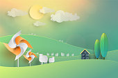 Wind turbine and white Sheep group farm on hill and cloud background in vintage Pastel Paper art cutting style