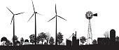 Wind Turbines in a field black silhouette. Landscape horizontal agriculture and rural farmland scene with wind turbines, old-fashioned style windmill, trees, barn, silos and grain silos clipart vector illustration.