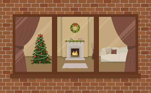 Window on the brick wall. View from the street side. Living room, decorated with Christmas decoration