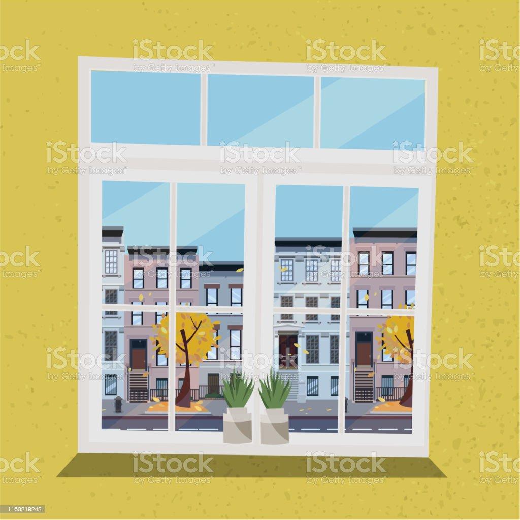 街の道路や黄色い木々葉を飛ぶ通りの家々の景色を望む窓植物と黄色の