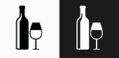 Wine and Glass Icon on Black and White Vector Backgrounds. This vector illustration includes two variations of the icon one in black on a light background on the left and another version in white on a dark background positioned on the right. The vector icon is simple yet elegant and can be used in a variety of ways including website or mobile application icon. This royalty free image is 100% vector based and all design elements can be scaled to any size.