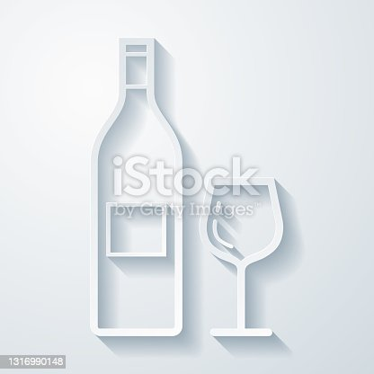 istock Wine bottle and wine glass. Icon with paper cut effect on blank background 1316990148