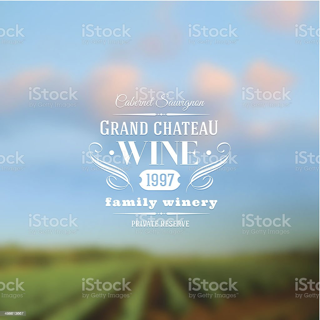 Wine label type design against a vineyards landscape defocused background vector art illustration