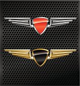 Vector illustration of winged insignias with enamelled shield-shaped buttons, in silver and red and in black and gold, over metal grill background.
