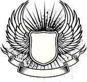 Winged shield tattoo