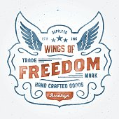Watercolor retro t-shirt apparel graphic design, vintage hand crafted logo 'Wings of Freedom' supply company, vector illustration