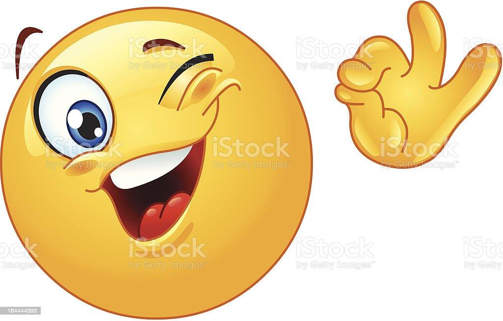 Winking emoticon Winking emoticon showing ok sign Emoticon stock vector