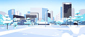 winter city snowy park downtown with skyscrapers business buildings cityscape background flat horizontal vector illustration