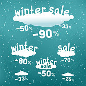 Winter sale text on white cartoon clouds with discounts and snow falling. Seasonal discount stickers set