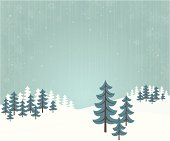 Retro styled fir trees in a forest with snowflakes falling.