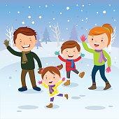 Winter fun. Happy family in the snow.