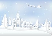 Winter holiday Santa and snow in city town blue sky background. Christmas season paper art style illustration.
