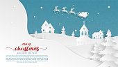 Winter landscape with Santa Claus on sleigh and reindeer flying over village on snowfield in paper cut style. Vector illustration. Christmas celebration greeting card, banner, poster, backdrop.