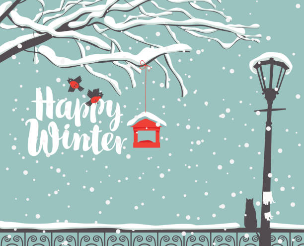winter landscape with snow-covered tree in park Vector winter scene at the snow-covered park with calligraphic inscription Happy Winter, with branches of a tree, bullfinches and a bird feeder, a street lamp and a cat on the fence in the snow december illustrations stock illustrations