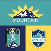 Flat design winter mountain ski symbol concepts. EPS 10 file. Transparency effects used on highlight elements.