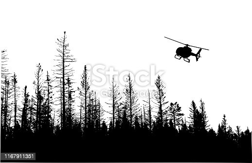 Landscape in silhouette with a treeline and helicopter in the sky