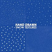 Falling snow vector seamless pattern. White splash on blue background. Winter snowfall hand drawn spray texture.