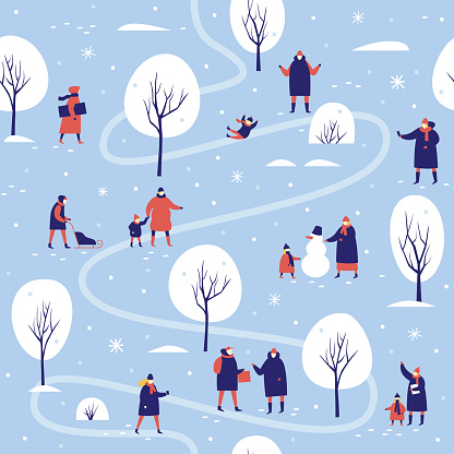 A winter walk of parents with children in the snow-covered park.