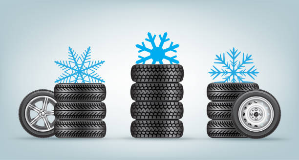 winter wheels set Winter wheels icon set with snowflake sign from above. Wintery tire collection and snow symbol cycle vehicle stock illustrations