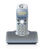 Wireless telephone with cradle