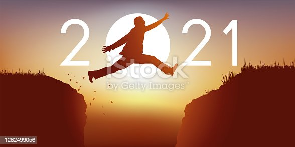 istock wish arte showing a man jumping between two rocks to pass in 2021. 1282499056