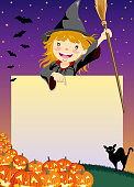 Halloween Witch pointing at copy space signboard template.