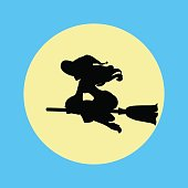 Witch silhouette on a moon background.