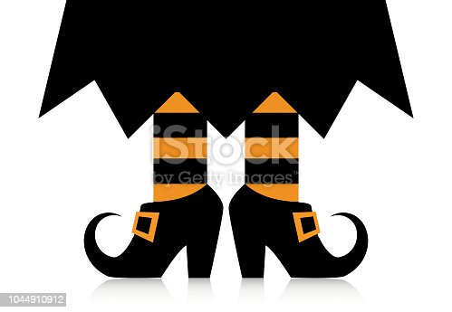 Legs of a witch in black shoes with buckles and striped stockings